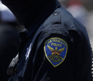 A San Francisco Police Department patch is shown on an officer's uniform in San Francisco, Tuesday, July 7, 2020.