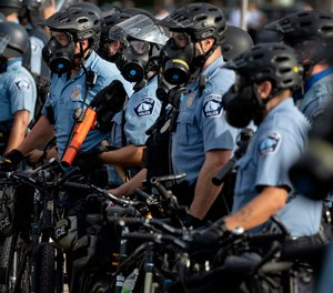 On May 27, 2020 police gather en masse as protests continue at the Minneapolis 3rd Police Precinct in Minneapolis.