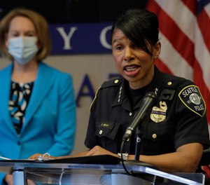 Seattle Police Chief Carmen Best, right, speaks, Monday, July 13, 2020, during a news conference at City Hall in Seattle with Mayor Jenny Durkan. (AP Photo/Ted S. Warren)