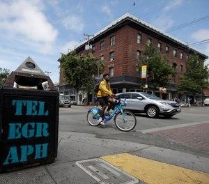 In this July 18, 2019, file photo, traffic and pedestrians cross Telegraph Avenue in Berkeley, Calif. (AP Photo/Jeff Chiu, File)