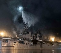 Sailors battle hot spots on 4th day of naval warship fire