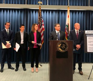 In this Feb. 10, 2020, file photo, California Attorney General Xavier Becerra, second from right, announces an independent review of LAPD's use of a gang member database after allegations of misuse in Los Angeles.