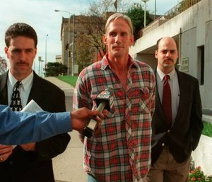 In this 1998 photo, Wesley Ira Purkey, center, is escorted by police officers in Kansas City, Kan., after he was arrested in connection with the death of 80-year-old Mary Ruth Bales. (Photo/Jim Barcus of The Kansas City Star via AP)