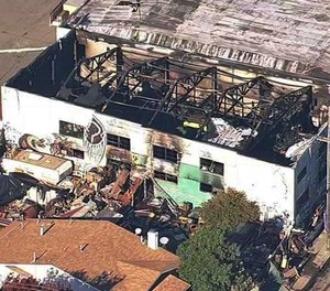 This Dec. 3, 2016, image shows the Ghost Ship Warehouse after a fire swept through the building in Oakland, Calif. Oakland will pay $32.7 million to settle lawsuits filed over the fire that killed 36 people at an illegally converted warehouse. (Photo/KGO-TV via AP)