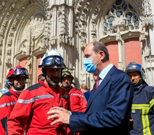 French Prime minister Jean Castex meets firefighters after the blaze at the Gothic St. Peter and St. Paul Cathedral in Nantes, France. The fire evokes memories of the devastating blaze in Notre Dame Cathedral in Paris last year. (AP Photo/Laetitia Notarianni, Pool)