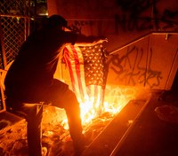 Federal officers gas Portland protesters who set fire at courthouse