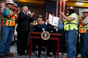 In this April 10, 2019, photo, President Donald Trump holds up an executive order on energy and infrastructure after signing it at the International Union of Operating Engineers International Training and Education Center in Crosby, Texas. Image: AP Photo/Evan Vucci