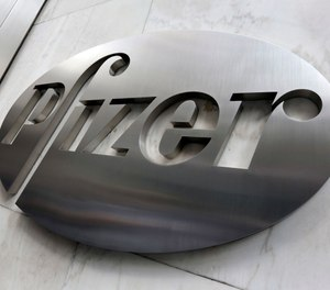 The federal government has agreed to pay nearly $2 billion for 100 million doses of a potential COVID-19 vaccine being developed by U.S. drugmaker Pfizer and its German partner BioNTech. (AP Photo/Richard Drew)