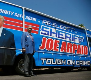 Former Maricopa County Sheriff Joe Arpaio, poses for a photograph in front of his campaign vehicle as he is running for the position of Maricopa County Sheriff again, Wednesday, July 22, 2020, in Fountain Hills, Ariz. AP Photo/Ross D. Franklin)