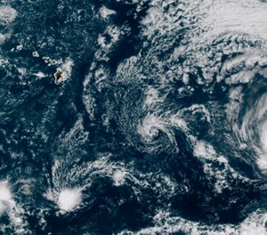 This GOES-17 taken at 3:30 p.m. EDT, Thursday, July 23, 2020, shows Hurricane Douglas, right, churning in the Pacific Ocean heading towards Hawaii, left. The storm is currently a Category 3 hurricane but is expected to weaken before it arrives in the state this weekend. (Photo/NOAA via AP)