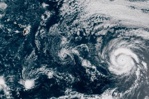 This GOES-17 taken at 3:30 p.m. EDT, Thursday, July 23, 2020, shows Hurricane Douglas, right, churning in the Pacific Ocean heading towards Hawaii, left. The storm is currently a Category 3 hurricane but is expected to weaken before it arrives in the state this weekend. Image: NOAA via AP