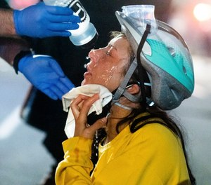 A federal judge has ruled that street medics must comply with lawful police orders to disperse during protests. (AP Photo/Noah Berger)