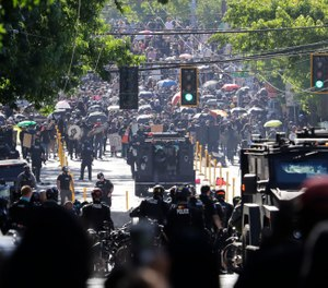 Police try to hold a line with protesters July 25, 2020, during a Black Lives Matter protest near the Seattle Police East Precinct headquarters in Seattle. (AP Photo/Ted S. Warren)