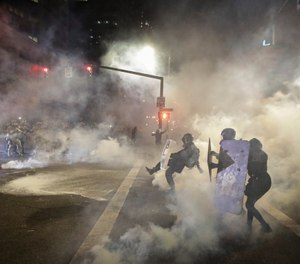 A large disturbance is an opportunity for officers to look very good or very bad in front of millions. (AP Photo/Marcio Jose Sanchez)