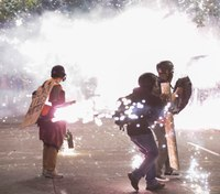 US agents use gas, flash bangs to clear Portland protesters