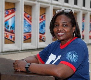 Karen Calloway, principal of Kenwood Academy in Chicago, poses Tuesday, July 28, 2020, for a portrait outside the Hyde Park neighborhood campus. (AP Photo/Charles Rex Arbogast)