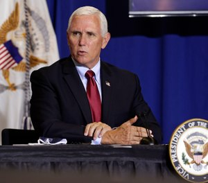 Vice President Mike Pence speaks at the NC Biotechnology Center where Phase-III trials for a Coronavirus vaccine are underway in Durham, N.C., Wednesday, July 29, 2020. (AP Photo/Gerry Broome)