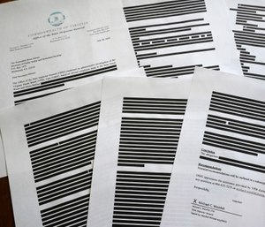 This photo shows a report provided by the Virginia Office of the State Inspector General to The Associated Press in response to an open records request. (AP Photo/Aaron Jackson)