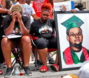Trinetta Brown, left, 19, and Triniya Brown become emotional during a memorial service for their brother, Michael Brown, Thursday, Aug. 9, 2018, in Ferguson, Mo. (Cristina M. Fletes/St. Louis Post-Dispatch via AP, File)