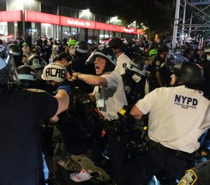 NYPD officers clash with demonstrators during a protest on July 25, 2020. The FDNY has formally prohibited the use of fire hoses on unruly crowds amidst ongoing demonstrations, the New York Post reports. (AP Photo/Yuki Iwamura)