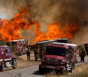 Roughly 2,300 fire personnel are battling the Apple fire in California, which had grown to 26,000 acres as of Monday. (AP Photo/Ringo H.W. Chiu)