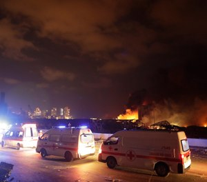 Ambulances drive past the site of a massive explosion in Beirut, Lebanon, Tuesday, Aug. 4, 2020. A San Antonio couple who survived the blast are raising money to by more ambulances for EMS providers in Lebanon. (AP Photo/Hassan Ammar)