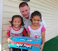 Kids surprise cop with ice pop on hot summer day; he returns the favor