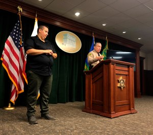 Los Angeles County Sheriff Alex Villanueva, right, announces the rollout of body-worn cameras for deputies during a news conference in Los Angeles on Wednesday, Aug. 12, 2020. (AP Photo/Stefanie Dazio)