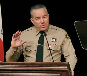 In this Dec. 3, 2018 file photo, Los Angeles County Sheriff Alex Villanueva speaks during a ceremony in Monterey Park, Calif. (AP Photo/Jae C. Hong, File)
