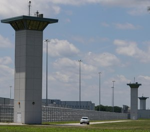 In this July 17, 2020, file photo the federal prison complex in Terre Haute, Ind., is shown. (AP Photo/Michael Conroy, File)