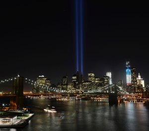 In this Sept. 11, 2012 file photo, the Tribute in Light lights up lower Manhattan in New York. Plans are back on to beam twin columns of light into the Manhattan sky to represent the World Trade Center during next month's anniversary of the 9/11 terror attacks. (AP Photo/Henny Ray Abrams)
