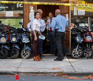 Police officers respond to a crime scene on Nostrand Avenue, where a man was discovered with gunshot wounds before being transported to a hospital where he died from his injuries in Brooklyn on Saturday, July 18, 2020. (AP Photo/John Minchillo, File)