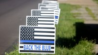 Woman who crumpled pro-police sign is charged with hate crime
