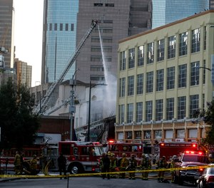 LAFD firefighters work the scene of a structure fire that injured multiple members in downtown Los Angeles. (AP Photo/Ringo H.W. Chiu, File)