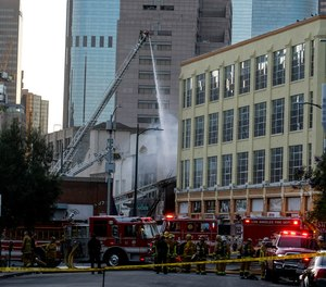 LAFD firefighters work the scene of a structure fire that injured multiple members in downtown Los Angeles.