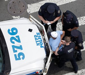 New York City police officers detain and question a man, Tuesday, July 11, 2017, in the Bronx borough of New York. (AP Photo/Mark Lennihan, File)