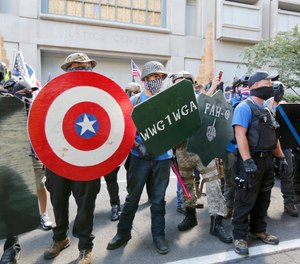 Opposing rallies battle with mace, paint balls and rocks near Justice Center in downtown Portland Saturday, August 22, 2020.