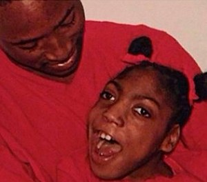 This undated family photo shows Timesha Beauchamp with her brother Steven Thompson. State regulators say a Southfield firefighter-paramedic misled a doctor on Beauchamp's condition before she was declared dead and later found alive at a funeral home. (Photo/Courtesy of Erica Lattimore through Fieger Law via AP)