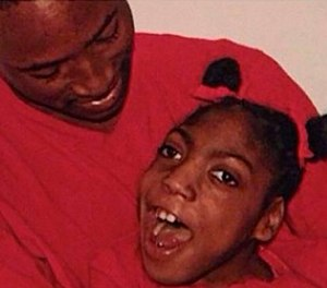 This undated family photo shows Timesha Beauchamp with her brother Steven Thompson. State regulators say a Southfield firefighter-paramedic misled a doctor on Beauchamp's condition before she was declared dead and later found alive at a funeral home.