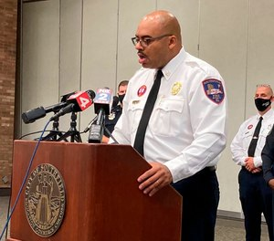 Southfield Fire Chief Johnny Menifee held a press conference Wednesday to address the case of a woman who was declared dead and later found alive at a funeral home. Two firefighter-medics who treated the woman have had their licenses suspended by the State of Michigan. (AP Photo/Ed White)