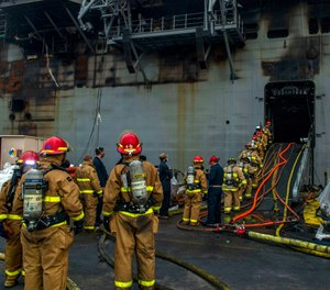 In this July 14, 2020 photo, sailors prepare to board the amphibious assault ship USS Bonhomme Richard to fight a fire in San Diego, Calif. A senior defense official says arson is suspected as the cause of the blaze, which burned for four days. (Photo/Mass Communications Specialist 3rd Class Jason Waite, U.S. Navy via AP)
