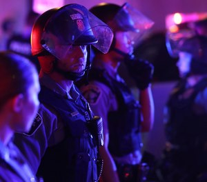 Minneapolis police secure an intersection along 7th St. during unrest near Nicollet Mall Wednesday, Aug. 26, 2020 in Minneapolis.