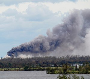 A fire at a chemical plant, BioLab Inc., burns on Thursday, Aug. 27, 2020, in Westlake, La., in the aftermath of Hurricane Laura. (AP Photo/Gerald Herbert)