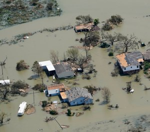 Buildings and homes are flooded in the aftermath of Hurricane Laura Thursday, Aug. 27, 2020, near Lake Charles, La. The storm killed at least six people in Louisiana. (AP Photo/David J. Phillip)