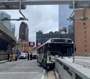 This photo provided by FDNY shows an NJ Transit bus that crashed near the Port Authority Bus Terminal in New York. The commuter bus crashed around 9:30 a.m. on an upper ramp at the Port Authority Bus Terminal in Manhattan, tossing passengers around and causing major damage to the vehicle's front end.