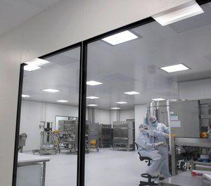 In this Aug. 14, 2020 photo, laboratory technicians work at the mAbxience biopharmaceutical company on an experimental coronavirus vaccine developed by Oxford University and the laboratory AstraZeneca in Garin, Argentina. The CDC has told states to be prepared to distribute a COVID-19 vaccine by Nov. 1. (AP Photo/Natacha Pisarenko, File)