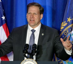 In this Feb. 10, 2020, file photo New Hampshire Republican Gov. Chris Sununu speaks at a rally in Portsmouth, N.H. (AP Photo/Robert F. Bukaty, File)