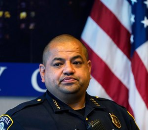 Interim Seattle Police Chief Adrian Diaz listens to a question during a news conference about changes being made at the department Wednesday, Sept. 2, 2020, in Seattle.