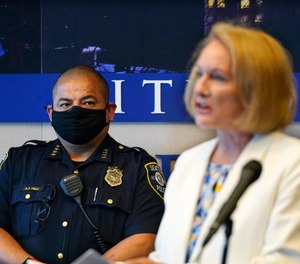 Interim Seattle Police Chief Adrian Diaz, left, looks on as Mayor Jenny Durkan addresses a news conference about changes being made at the police department, Wednesday, Sept. 2, 2020, in Seattle.