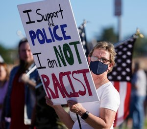 Law enforcement supporters protest during a Back the Blue rally Thursday, Sept. 3, 2020, in West Valley City, Utah.